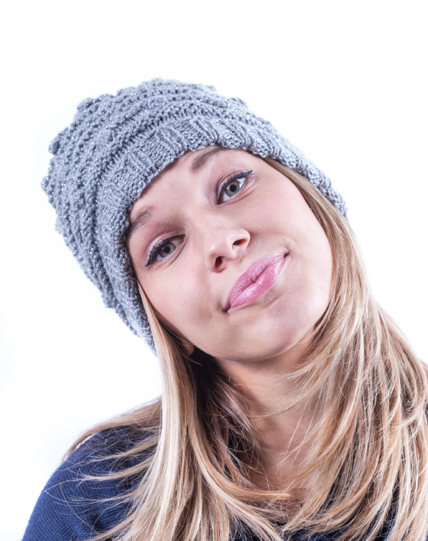 Teen girl with knit hat and cardigan